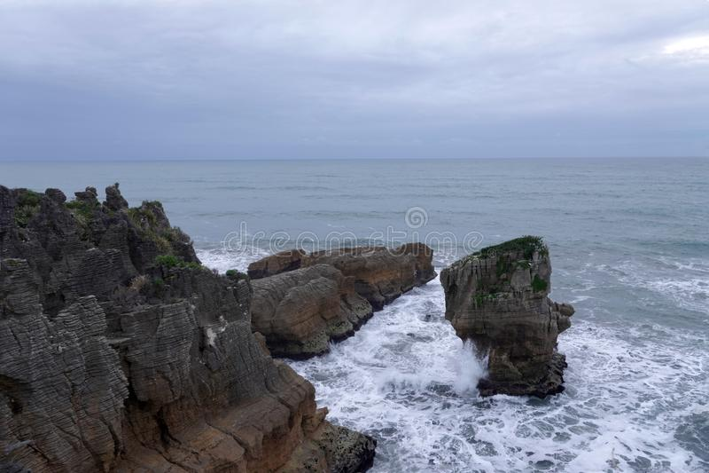 Punakaiki rocks and Tasman Sea on West Coast of New Zealand. Pancake rocks in Tasman Sea on Wast Coast at Punakaiki on the South Island of New Zealand on a stock images