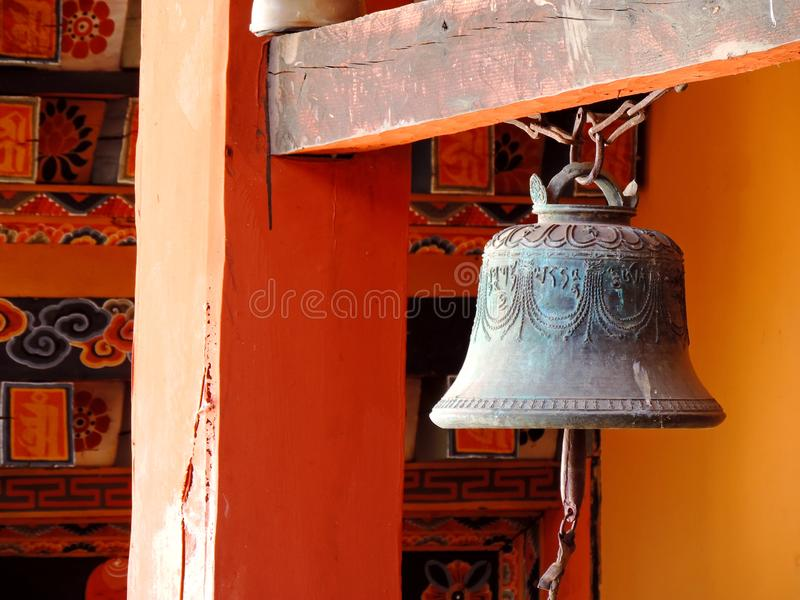 Bell at Punakha Dzong, Bhutan. The Punakha Dzong, also known as Pungtang Dewa chhenbi Phodrang meaning `the palace of great happiness or bliss`, is the royalty free stock image