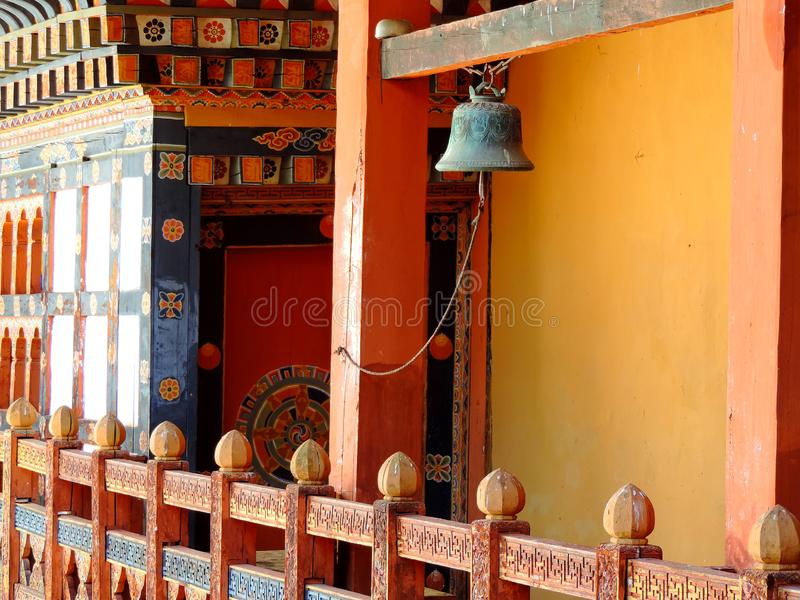 Bell at Punakha Dzong, Bhutan. The Punakha Dzong, also known as Pungtang Dewa chhenbi Phodrang meaning `the palace of great happiness or bliss`, is the stock image