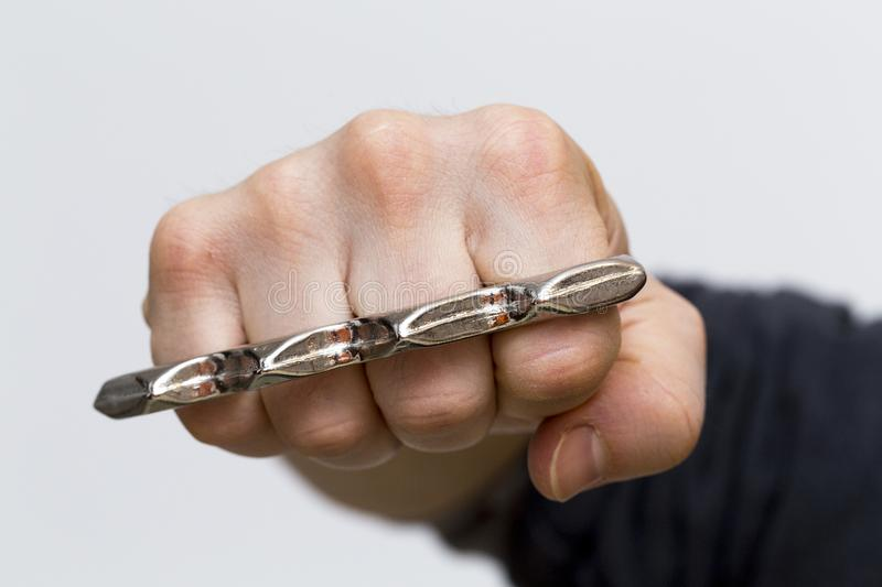 A punch with brass knuckles royalty free stock photos