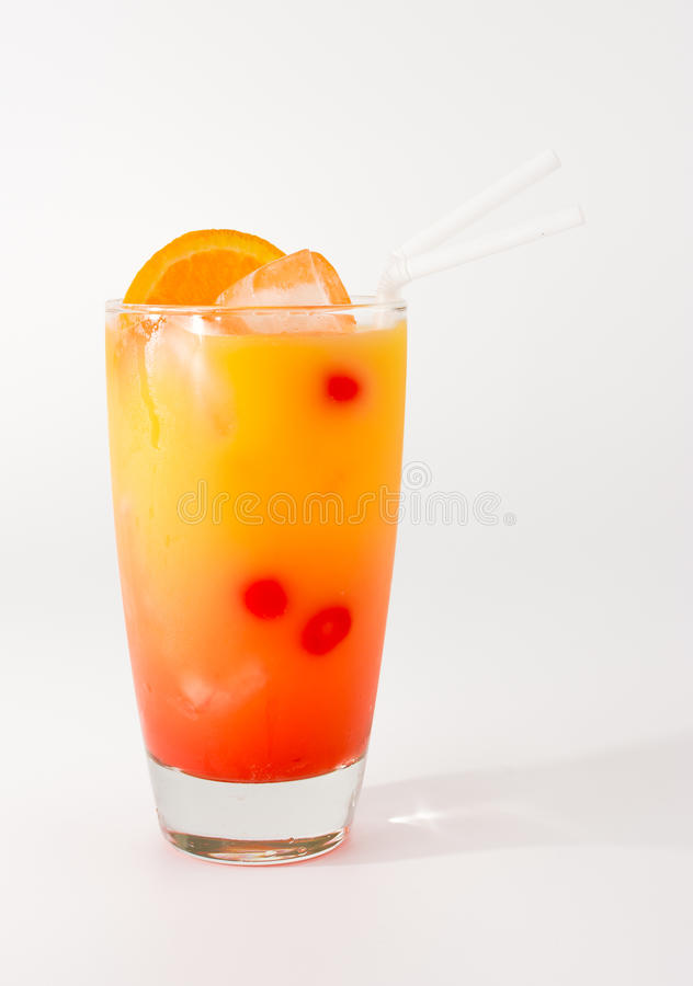 Punch Cocktail. Colorful and cold punch coctail in a long glass royalty free stock image