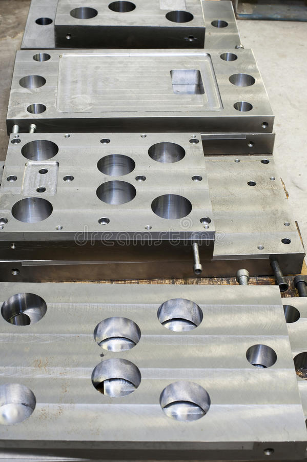 Punch press tooling. Steel detail for lathe and milling industry stock photo