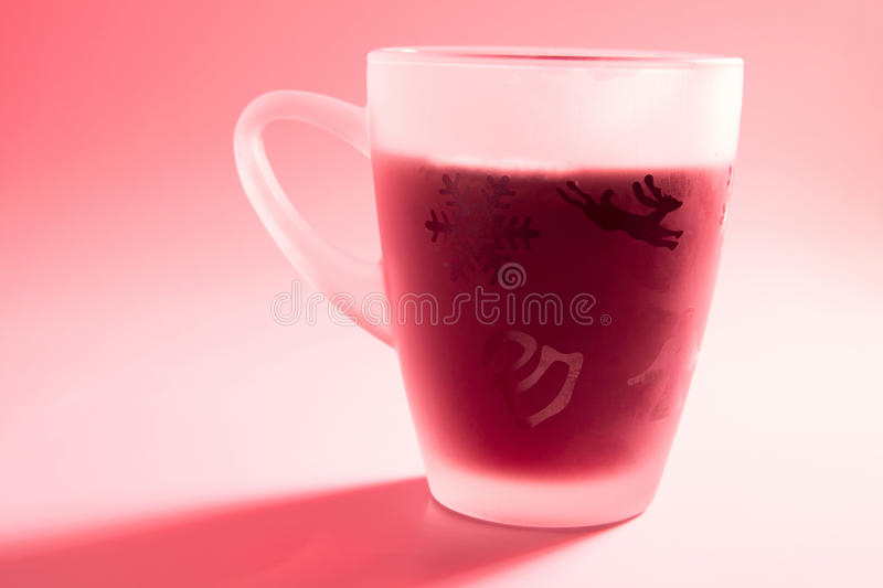 Punch. Red is the main color of this picture of a cup of punch royalty free stock image