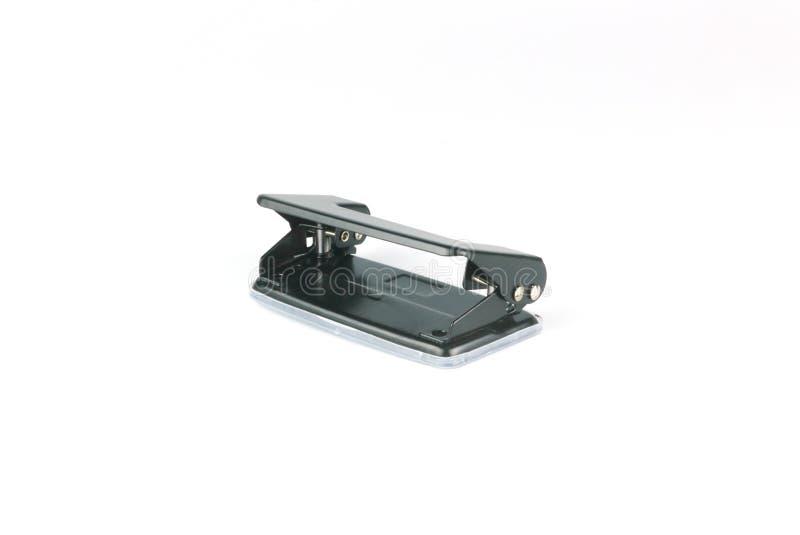 Puncher de agujero inmóvil de la oficina del metal negro del papel aislado en el fondo blanco fotos de archivo libres de regalías