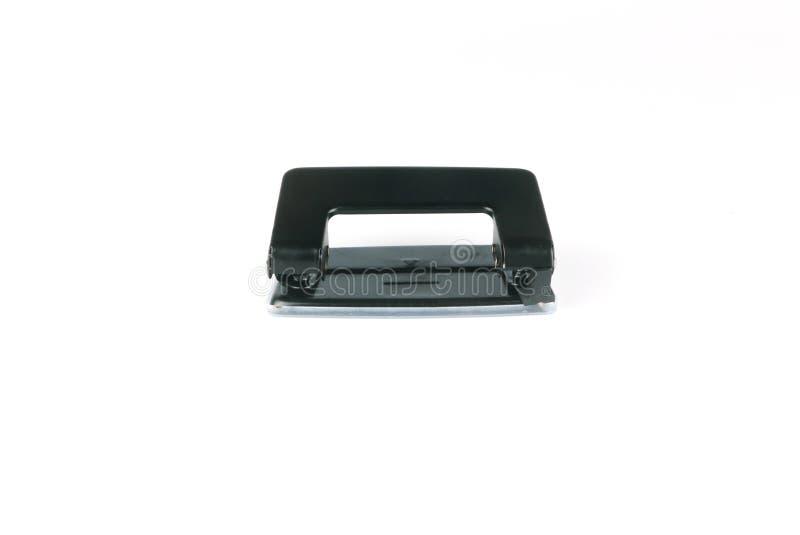 Puncher för hål för svart kontorspappersmetall som stationär isoleras på vit bakgrund royaltyfri bild