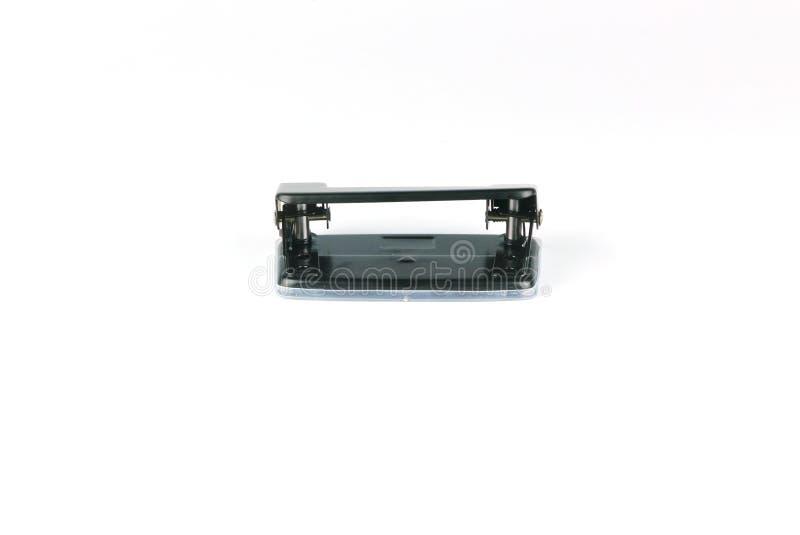 Puncher för hål för svart kontorspappersmetall som stationär isoleras på vit bakgrund royaltyfria foton