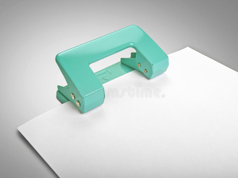 Puncher Iand Paper Sheet Royalty Free Stock Images