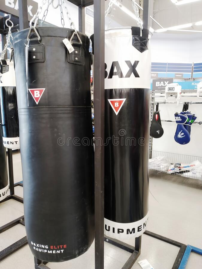 Punching bags for boxing sold at a sports store stock photos