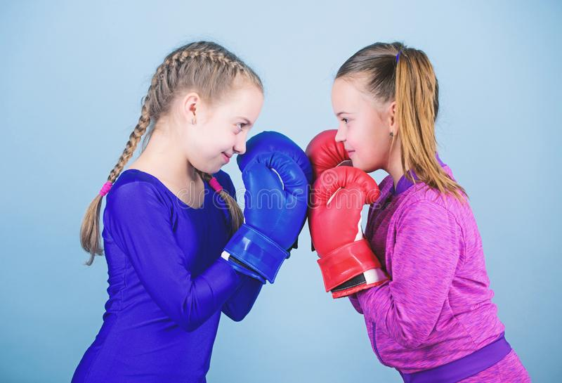 Punching knockout. Childhood activity. Fitness diet. energy health. workout of small girls boxer in sportswear. Sport. Success. Friendship. Happy children royalty free stock photo