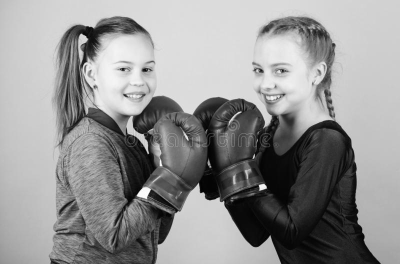 Punching knockout. Childhood activity. Fitness. energy health. Sport success. Friendship. Happy children sportsman in. Boxing gloves. workout of small girls royalty free stock image