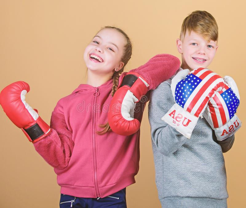 Punching knockout. Childhood activity. Sport success. Friendship fight. workout of small girl and boy boxer in royalty free stock photography