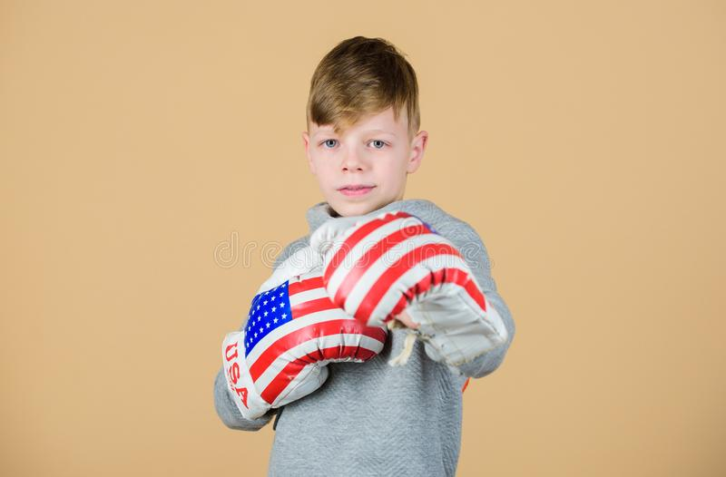 Punching knockout. Childhood activity. workout of small boy boxer. Sport success. Confident in his fitness regime. Energy health. usa independence day. Happy stock photos