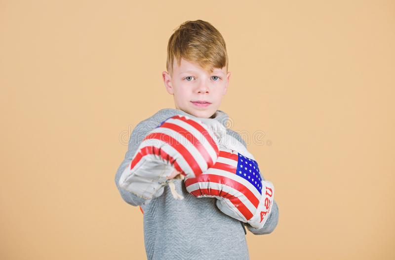 Punching knockout. Childhood activity. workout of small boy boxer. Sport success. Confident in his fitness regime. Energy health. usa independence day. Happy stock photography