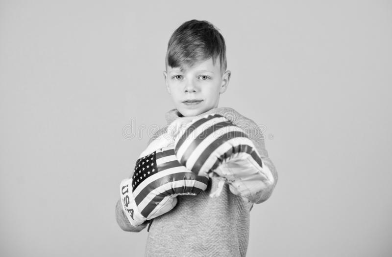 Punching knockout. Childhood activity. workout of small boy boxer. Sport success. Confident in his fitness regime. Energy health. usa independence day. Happy royalty free stock photos