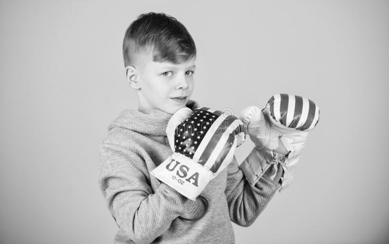 Punching knockout. Fitness diet. energy health. Sport success. sportswear fashion. usa independence day. Happy child. Sportsman in boxing gloves. workout of royalty free stock photos