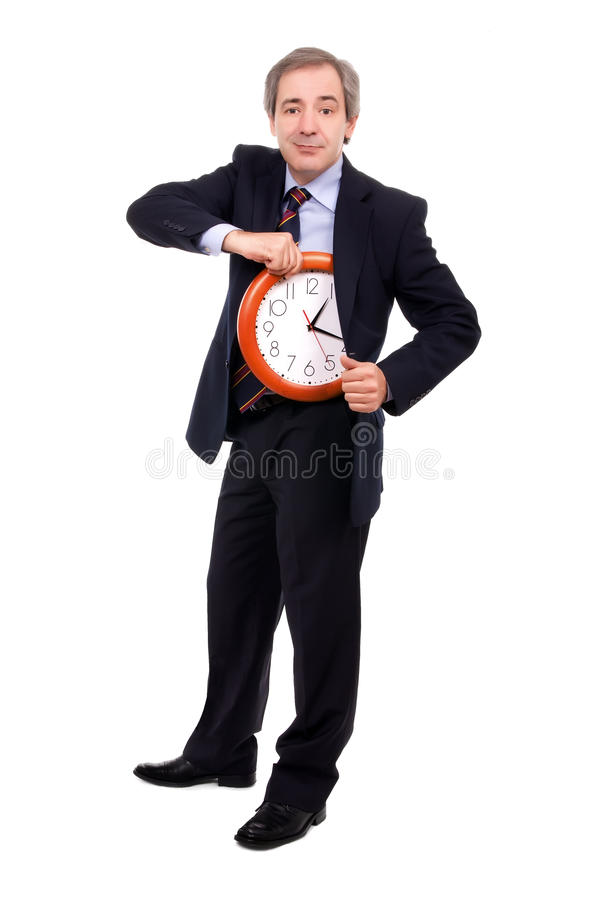 Punctuality. Man pulling clock out of jacket over white stock photography
