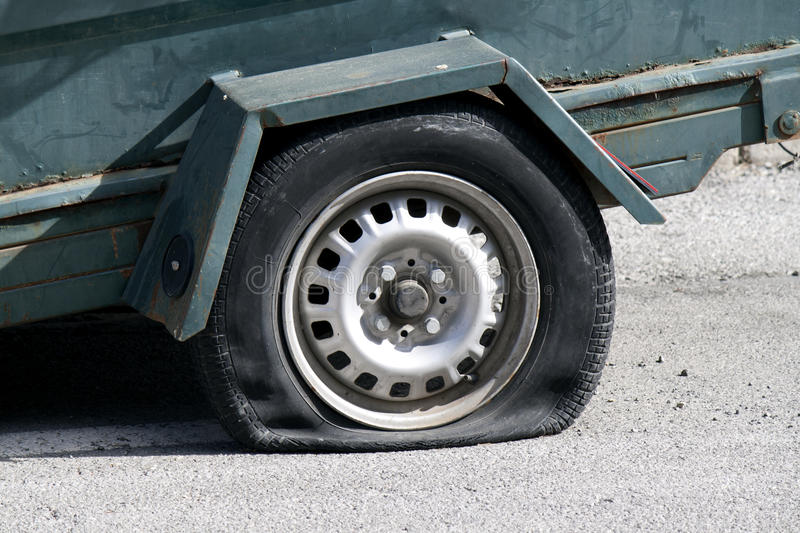 Punctured Tyre Royalty Free Stock Photos