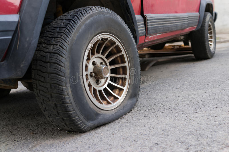 Punctured tyre royalty free stock image