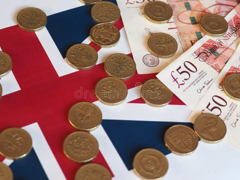 Pundmynt och anmärkningar, Förenade kungariket över flagga royaltyfri bild