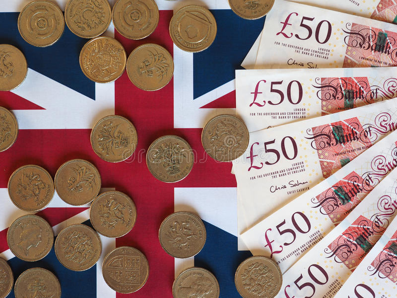 Pundmynt och anmärkningar, Förenade kungariket över flagga arkivbilder