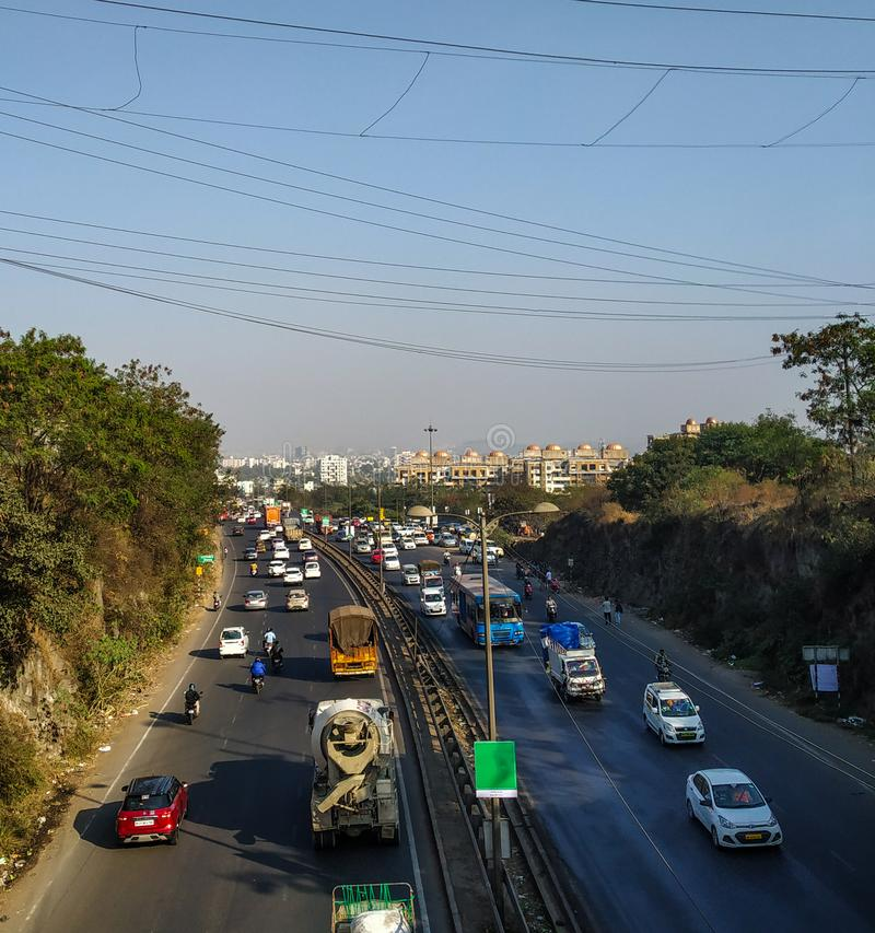 Pune banglore highway in india a view from chandani chowk, pune, India. With lot of traffic on it and a view of city in background royalty free stock image