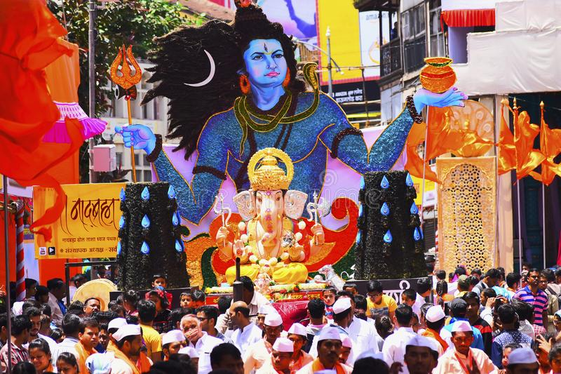 PUNE, INDIA, September 2016, People at Ganesh Festival Procession with Lord Shiva and Ganesh idol decoration. stock photo