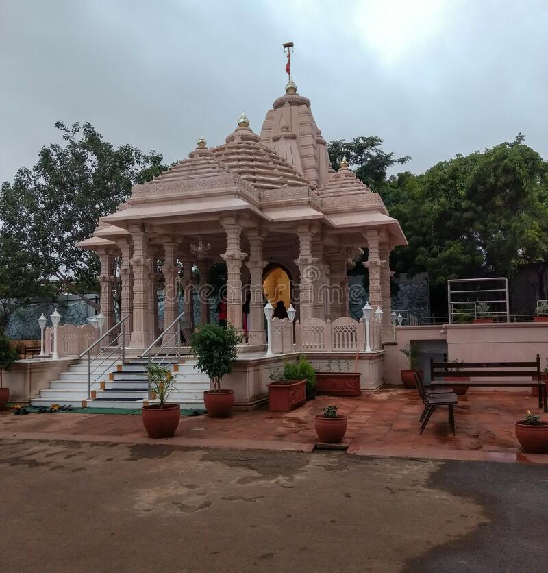 Pune, india, 8-13-2018 : shiva temple, punya dham ashram. Which has a garden for children and seats for elderly stock photo