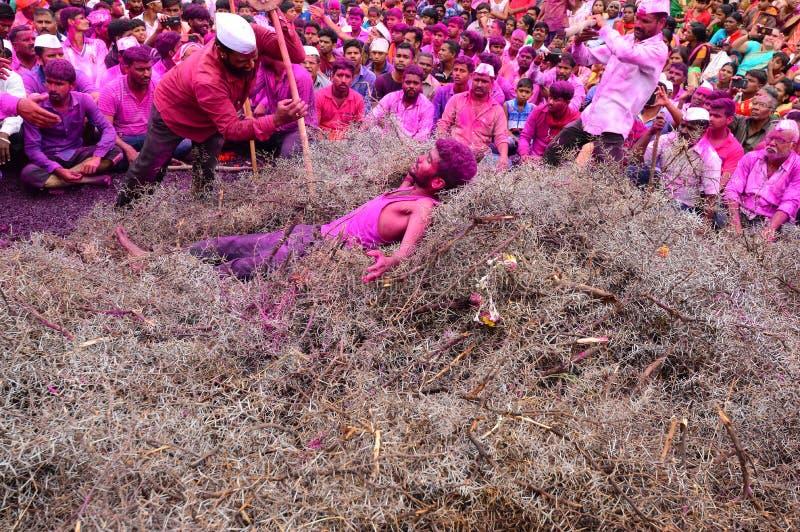 PUNE, MAHARASHTRA, INDIA, November 2018, Devotee lying on thorns during Kate Baras yatra. PUNE, MAHARASHTRA INDIA November 2018, Devotee lying on thorns during stock photos