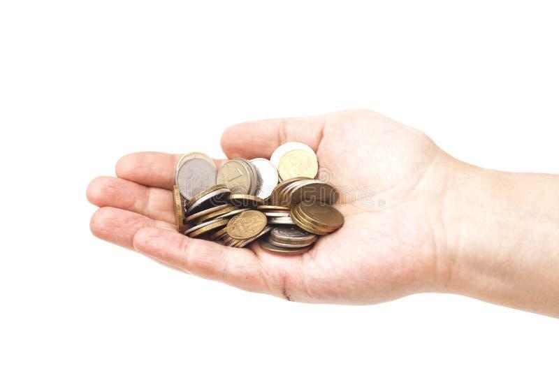 Punhado das moedas na mão da palma fotos de stock royalty free