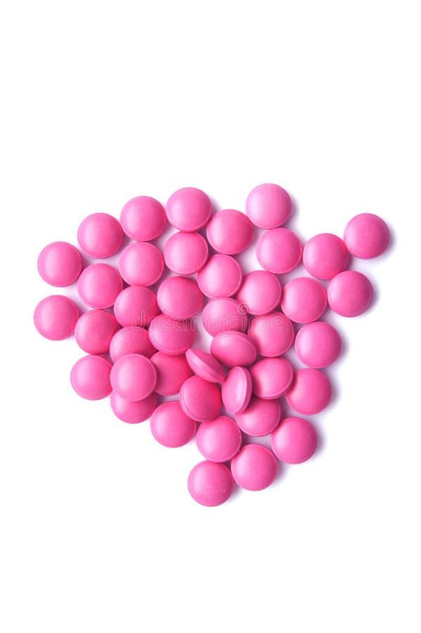Punhado de tabuletas cor-de-rosa fotos de stock royalty free