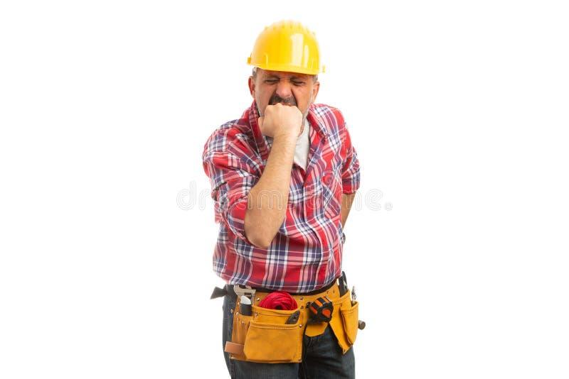 Punho da exibição do trabalhador da construção como o gesto irritado fotografia de stock