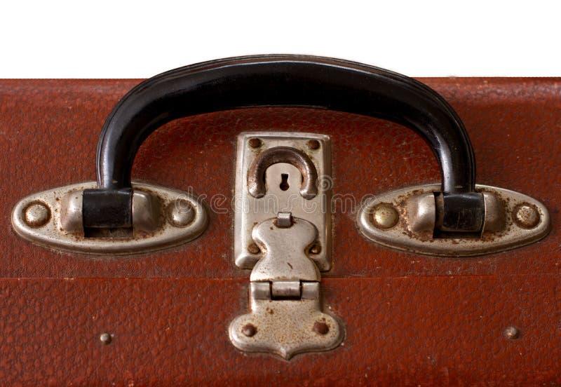 Punho velho isolado de Dusty Brown SuitcaseIsolated do vintage de um Vinatge idoso Dusty Brown Suitcase imagem de stock