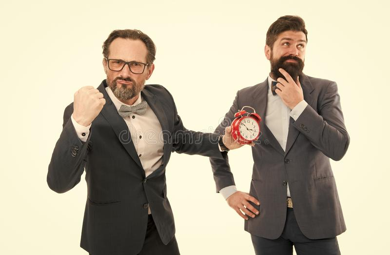 Punish for not punctuality. Business people formal clothes having different opinion about time. Time management royalty free stock photos