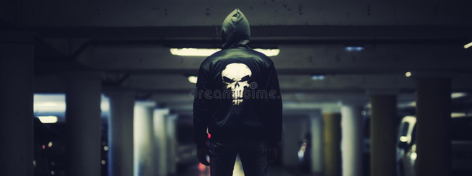 Punisher, panoramic view. Man in a car park stock image