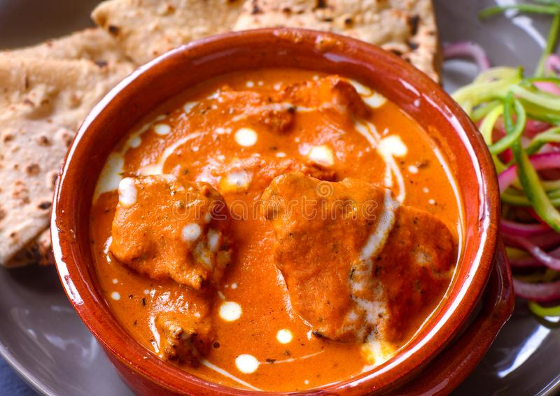 Punjabi Chicken Curry meal with roti and salad. Indian Dish of Chicken curry with tandoori roti or naan flatbread and salad stock photo