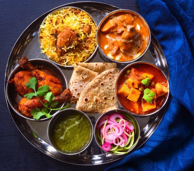 Indian non-vegetarian Meal -Butter Chicken, rajma, biryani with roti and salad. Punjabi non vegetarian meal consisting of butter chicken curry, chicken biryani stock photos