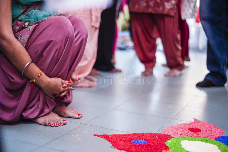 Punjabi Wedding Ceremony. Punjabi bride's hands and feet in a crowd during her wedding ceremony stock images