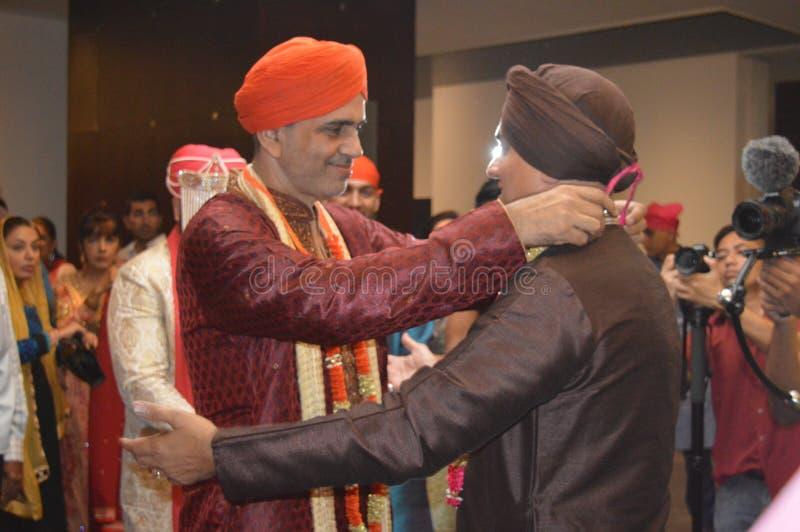 Punjabi Wedding Function. Where the bride and bridegroom parent meet stock photography