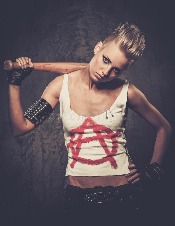 Punk girl with a bat stock photo