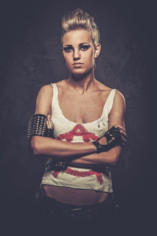 Punk girl with bracelets stock image