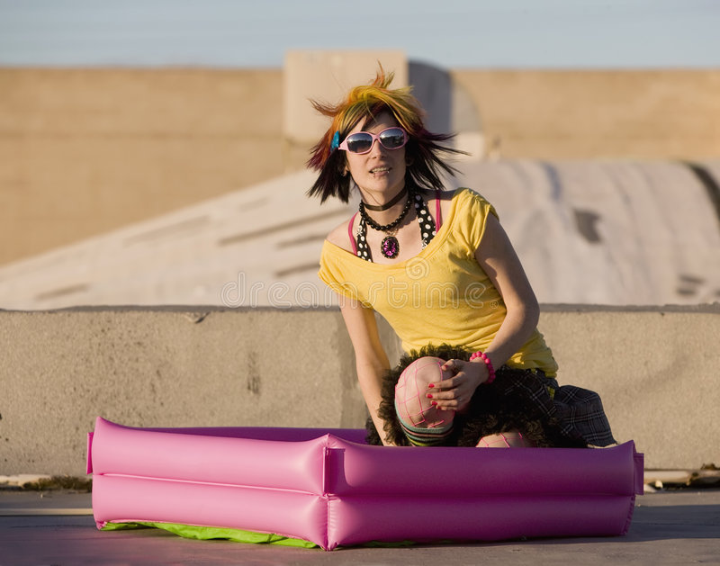 Punk Girl with Bright Clothes and Big Sunglasses. Portrait of a Punk Girl with Bright Colorful and Big Sunglasses Outdoors at Sundown stock photo