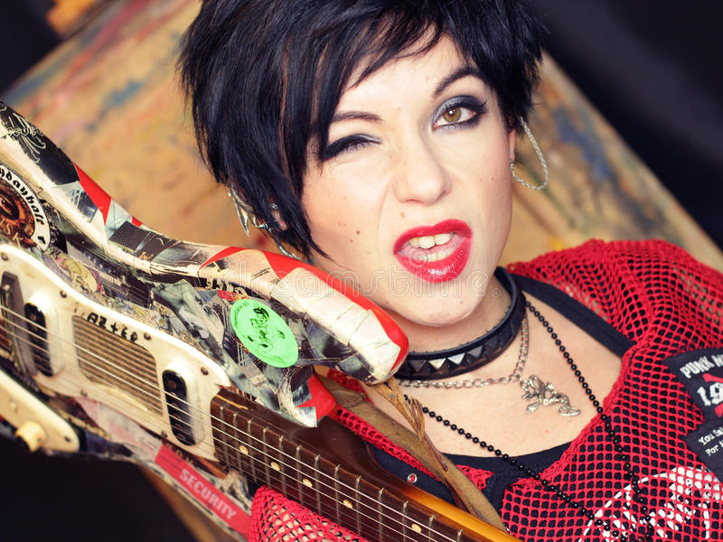 Punk girl with guitar. Portrait of black hair punk girl with guitar stock photos