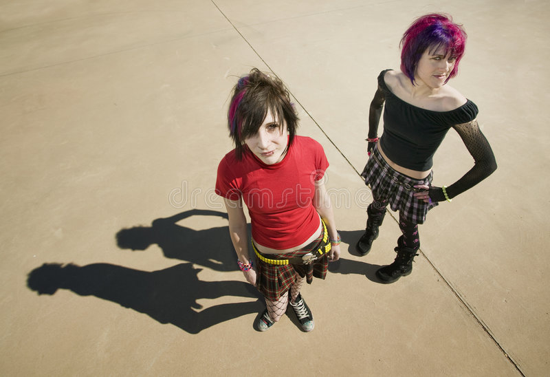 Punk Girls on Concrete. Two Punk Girls Standing on a Concrete Slab royalty free stock images