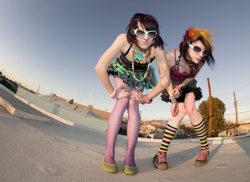 Punk Girls on a Roof. Fisheye shot of girls in brightly colored clothing on a roof stock photos