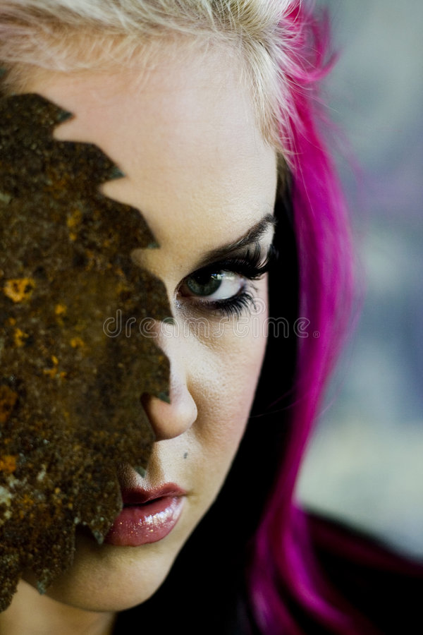 Punk gothic fashion model. A punk gothic style fashion model holding a rusty saw blade stock photo