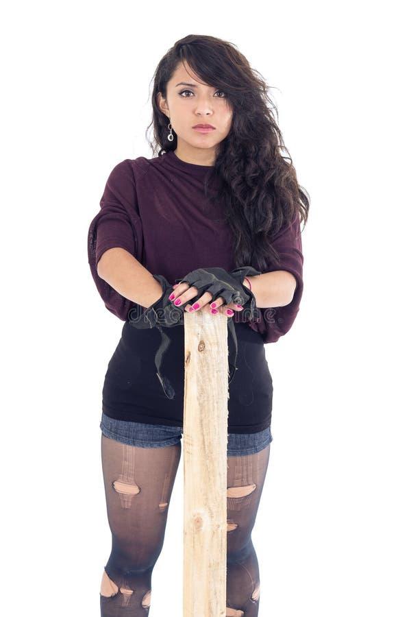 Punk jong meisje met pice van hout stock afbeelding