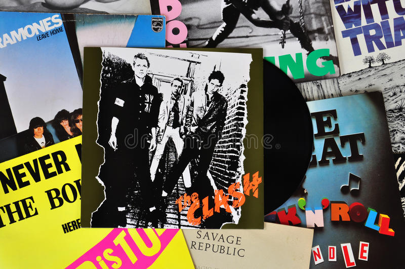 Punk vinyl records. ATHENS, GREECE - MARCH 6, 2014: Vinyl records of punk rock bands and the debut album by The Clash released in 1977. Vintage LP album sleeves royalty free stock photography