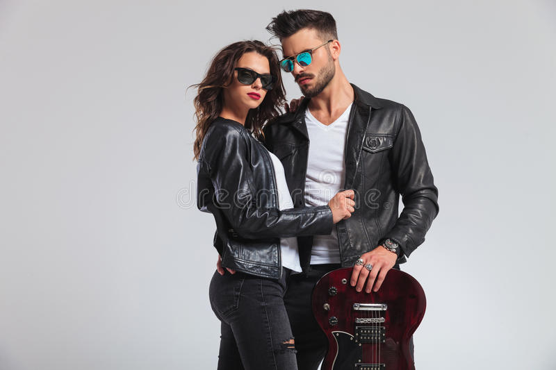 Punk woman holding her man by jacket royalty free stock image