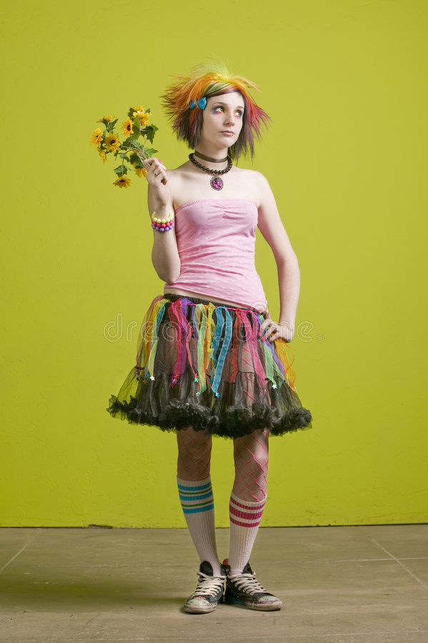 Punk woman with plastic flowers. Pretty young woman with colorful punk clothes with plastic flowers stock images
