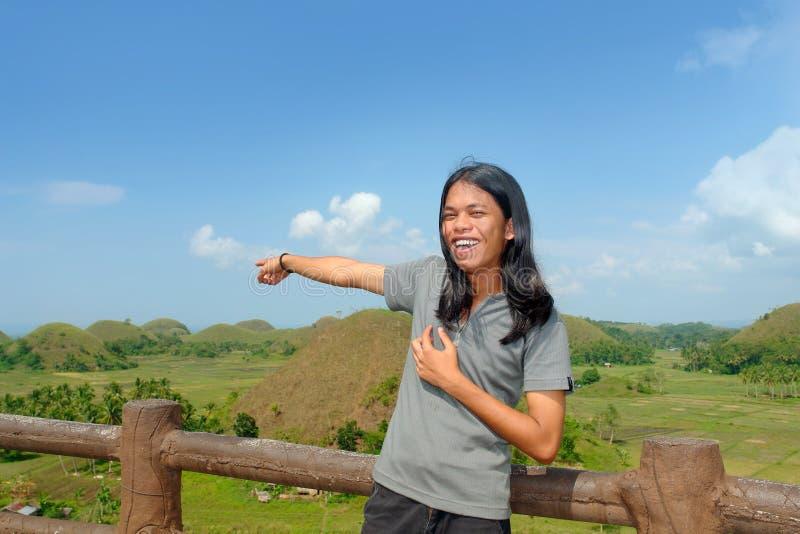punkt zwrotny azjatykci pokazuje młodego turystyczne obrazy stock